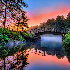 Sunrise Bridge by Trevor Pottelberg - Landscapes Sunsets & Sunrises ( calm, reflection, paddles, canoe, landscape, rustic, sun, tranquil, provincial park, soothing, nature, ontario landscape photographer, t.pottelberg, camping, rocks, granite, water, clouds, grundy lake provincial park, peaceful, t.pottelberg scenics, canada, ontario scenic photographer, ontario, scenic, morning, northern, fog, trevor pottelberg, trees, summer, sunrise, bridge, mist )