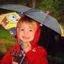 Smiling in the Rain by Pamm Smith - Babies & Children Toddlers ( boys, umbrella, smiling in the rain, grandson, rain )