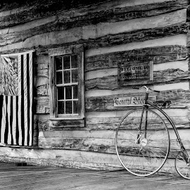 Country Store by Sandi Phillips Miller - Black & White Buildings & Architecture ( flag, bike, ohio, patriotic, black and white, general store, robbins crossing, bicycle, september )