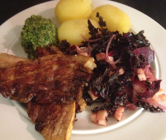 Crispy pork belly with green kale salad, parsley pesto and boiled potatoes