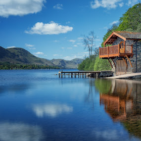 Reflection of the Duke of Portland Boathouse by Andy Young - Landscapes Waterscapes ( clouds, uk, england, ulswater, blue sky, pooley bridge, cumbria, reflections, long exposure, duke of portland boat house, lake district )