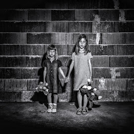 Lost by Mario Toth - Babies & Children Child Portraits ( expression, caucasiam, lost, black and white, sadness, suffering, pain, solitude, people, missing, looking, spooked, sisters, girl, desperate, bricks, lonely, alone, despair, unhappy, stress, problem, terrified, youth, siblings, young, lonelinesss, orphans, emotional, dress, toys, abandoned )