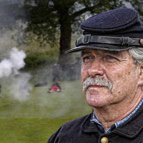 Facing The Guns by Jon Sellers - People Portraits of Men