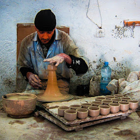 Moroccan Pottery Worker by Tom Howes - Professional People Factory Workers ( morocco )