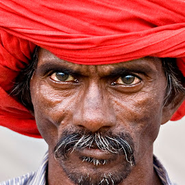India by Diego Scaglione - People Portraits of Men ( looking, red, beard, indian, eyes )