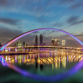 Dubai Water Canal by Wissam Chehade - Buildings & Architecture Bridges & Suspended Structures ( canon, dynamic, water, clouds, skyline, mydubai, colorful, blue hour, beautiful, reflections, cityscape, city, bujr khalifa, sky, dubai, uae, dramatic, long exposure, sunrise, bridges )