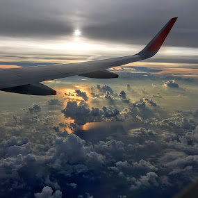 sunrise above the clouds by Wan Loy Yeong - Landscapes Cloud Formations ( cloud formations, clouds, window, airplane, sunset, aircraft, cloudscape, cloud, aerial, sunshine, sunrise, aerial view, singapore,  )