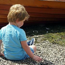 Throwing pebbles by Ingrid Anderson-Riley - Babies & Children Children Candids