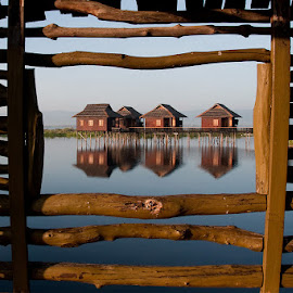 Reflections on the lake by Elaine Springford - Buildings & Architecture Homes ( myanmar, houses, village, reflections, lake, sunrise )