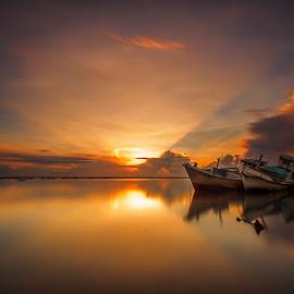 Morning Rays by Choky Ochtavian Watulingas - Landscapes Travel ( seashore, boats, cloud, reflections, seascape, sunrise, rays, skies, sun rays )