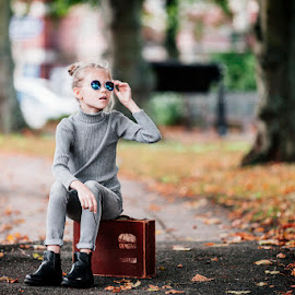 Marta by Andris Rutulis - People Fashion ( girl child, suitcase, autumn colors, street scene, sunglasses, street photography )