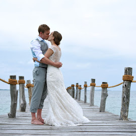 On the boardwalk by Andrew Morgan - Wedding Bride & Groom ( love, kiss, blue, wedding, sea, pier, beauty, bridge )