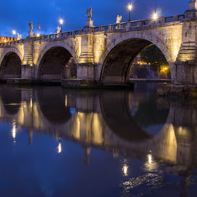 by Tracey Dolan - Buildings & Architecture Bridges & Suspended Structures ( calm, detail, europe, location, castle sant angelo, statues, reflections, visit, architecture, travel, across, tiber, historic, city, lamps, clear, lights, sky, details, tourists, city-scape, bricks, place, district, construction, evening, sightseeing, water, may, twilight, tourism, dusk, visitor, angle, reflecting, destination, tourist, european, season, rome, blue, serene, arches, popular, architectural, bridge, river )