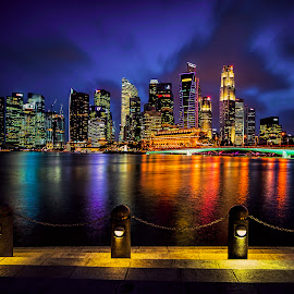 Dance of the clouds by Gordon Koh - City,  Street & Park  Night ( shenton way, clouds, reflection, skyline, marina bay sands, cityscape, singapore, city, lights, fullerton, skyscraper, vista, asia, mbs, night, long exposure, waterfront )