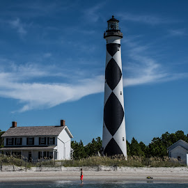 Look Out Lighthouse by Thomas Shaw - Landscapes Beaches ( clouds, water, sand, cape look out, lighthouse, white, ocean, house, beach, people, coast, north carolina, sky, blue, look out, sea oats, trees, light, black )