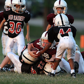Pile Up by Keith Johnston - Sports & Fitness American and Canadian football ( playing, field, uniforms, ball, football, helmets, competitors, action, tackle, game, youth, competition )