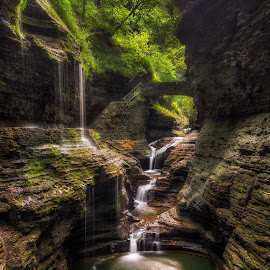Rainbow Falls by Mark Papke - Landscapes Caves & Formations ( cascading waterfall, stream, shrubbery, gorge, waterfall, stone walls, moss, landscape, leaves, photography, frothy, wall art, outdoors photography, tranquil, daytime, stairs, nature, fluid, pool, wating room art, state park, rapids, rainbow falls, crashing, motion, rocks, new york state parks, water, mark papke photography, peaceful, flowing, calming, art, canyon, cascades, white waters, tourism, new york, watkins glen, scenic, serene, outdoors, trees, scenery, bridge, daylight, outside, river )