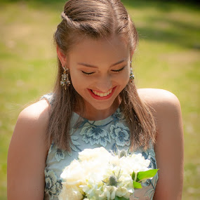 Teenage Girl Looking at Bouquet by Kevin Beasley - People Portraits of Women ( prom, bouquet, wedding, portrait, girl, teenager )