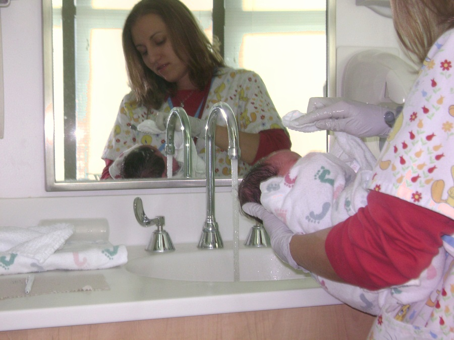 Baby's First bath  by Jannice Walker - Professional People Doctors & Nurses