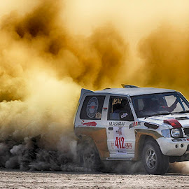 Evo Red&White by Abdul Rehman - Sports & Fitness Motorsports ( clouds, water, natural light, baluchista, sand, desert, dust clouds, dangerous, sun, beautiful light, rally, thrill, jhal magsi, pakistan, adventure, dust cloud, dangerous sport, dust, sun light )