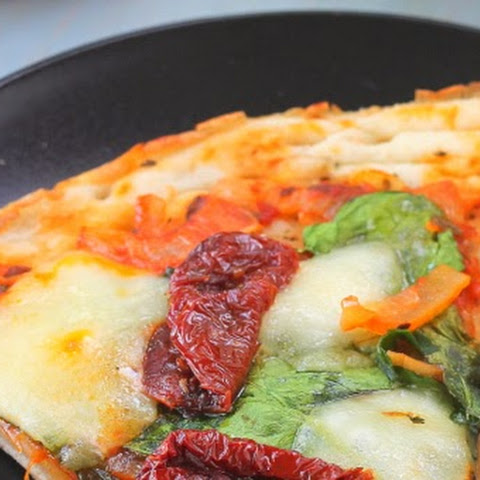 Tomato Caramelized Onion and Spinach Pizza