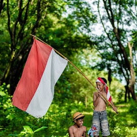 by Eko Probo D Warpani - Babies & Children Children Candids ( canon, strobist, green, nikkor, children, candid, tamron, sony, child, playing, colour, flag, nature, village, color, happy, indonesia, nikon, tokina )