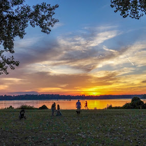 Summer evening on the Mississippi River Banks by Joe Machuta - City,  Street & Park  City Parks