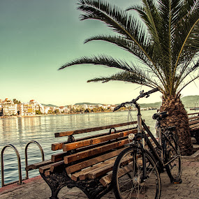 Dolce Vita by Vassilios Zacharitsev - City,  Street & Park  Street Scenes ( color, greece, film look, pier, travel, bicycle )