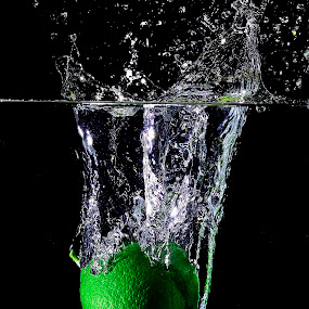 Alone in the deep... by Pete G. Flores - Food & Drink Fruits & Vegetables ( sparkling clear clean otep autofocus, green fruits, vegetables food splash water drop dip deep drop )