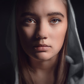Distant by Bendik Møller - People Portraits of Women ( black background, face, model, girl, color, female, close up, hood, closeup, portrait, eyes, close )