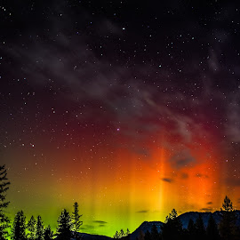 Aurora, Stars, and Clouds by Leon Kauffman - Landscapes Starscapes ( mountains, silhouette, montana, northern lights, aurora borealis, aurora, swan valley )