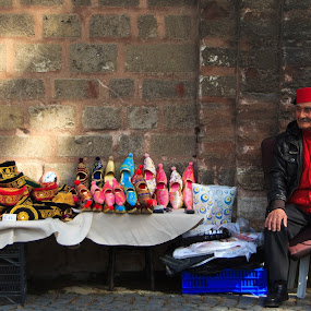 Turkish Atire Salesman by Tom Howes - City,  Street & Park  Street Scenes ( 2013, turkey )