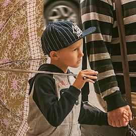 Child with umbrella by Jose Hernan Cibils - City,  Street & Park  Street Scenes ( colour, umbrella, street, boy, father )