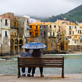 Cefalu, Sicily, Italy by Diana Garbacauskiene - City,  Street & Park  Historic Districts ( bench, city view, historic buildings, romantic, cefalu, scenic view, couple, italy, rain, sicily )