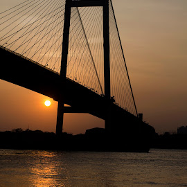 Sailing Through by Atin Saha - Buildings & Architecture Bridges & Suspended Structures ( kolkata, sunset, 50mm, boat, nikon, sun, golden hour, river )