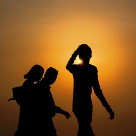 Sun sneaking through - silhouette by Hariharan Venkatakrishnan - People Street & Candids
