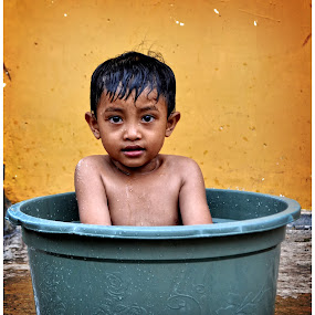 Bathing in a bucket by Teguh Gogo - Babies & Children Child Portraits