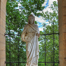 St. Elizabeth of Hungary by Darin Williams - Buildings & Architecture Statues & Monuments ( clouds, hungary, statue, sky, church, iron fence, st. elizabeth, leaves, eureka springs, arkansas )