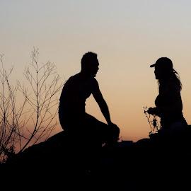 Couple by Barbara Nuetzmann - People Couples ( love, sitting, couple, rocks )