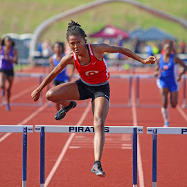 Running to an overall state record. by James Mathews - Sports & Fitness Running ( hurdles, high school, track, clinton high school, mississippi )