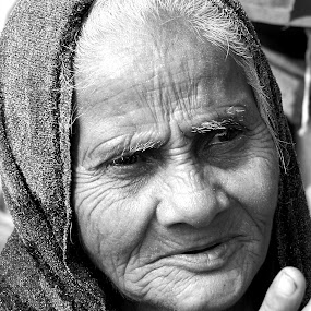 Worried..... by Avijit Basak - People Portraits of Women ( old, winter, worried, shadow, women )