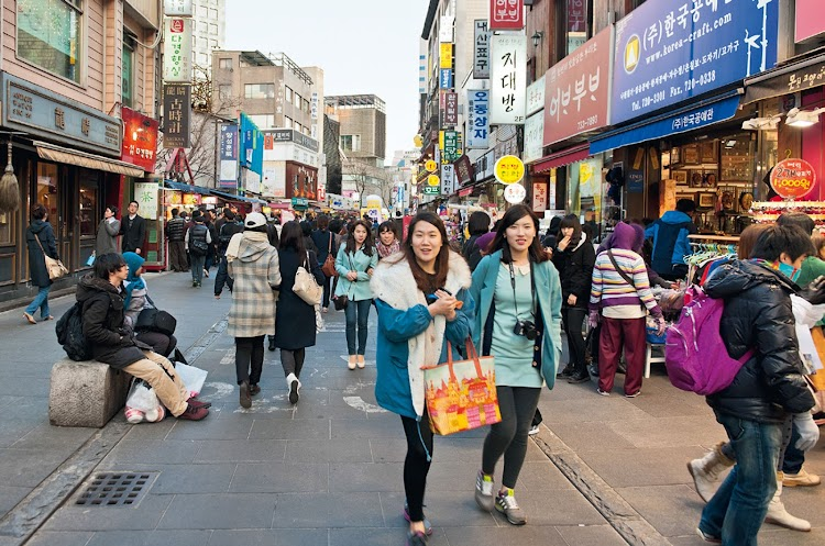 Other women walking through the city in South Korea