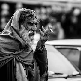Surveying The Crowd by Inayat Shah - People Street & Candids ( pakistan, islamabad, black and white )