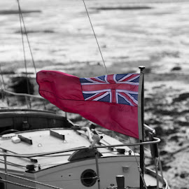 by Stuart Byles - Transportation Boats ( wind, bosham, jack, b&w, 85mm, white, sea, quay, flats, boat, flag, red, mud, sailing, ensign, union, tide, sail, low )
