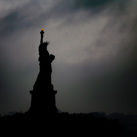 Statue of Liberty Silhouette by Chris Mowers - Buildings & Architecture Statues & Monuments ( torch, statue of liberty, silhouette, dark, new york )