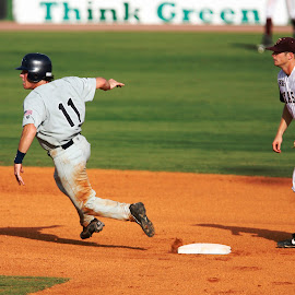 Heading for third by Keith Johnston - Sports & Fitness Baseball ( infield, second base, baseball, infielder, college, action, game, runner, dirt )