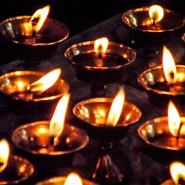 New year prayers by Geetika Johnson - Novices Only Macro ( lamps, prayer, new year, faith, monastery, celebration )