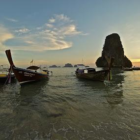 Railay Bay, Thailand by Jordan Wangsgard - Transportation Boats ( foriegn, longtailboat, sunset, boats, asia, thailand, thai, rock, ocean, longtail, transportation, travel )