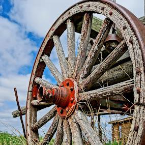 Wagon Wheel in the Sun by Barbara Brock - Artistic Objects Antiques ( wooden wheel, wagon wheel, cloudy skies, old wheel )