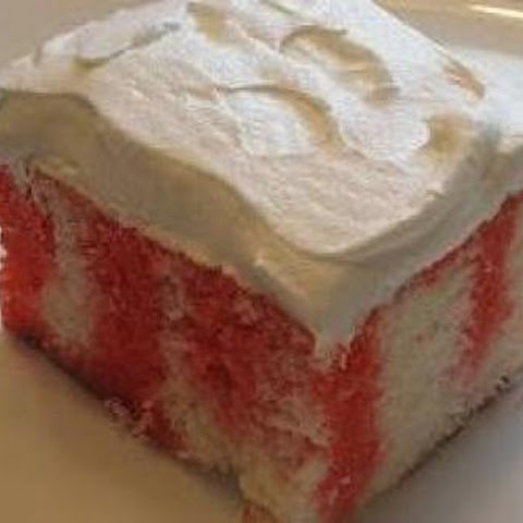 Strawberry jello poke cake with Cool Whip topping